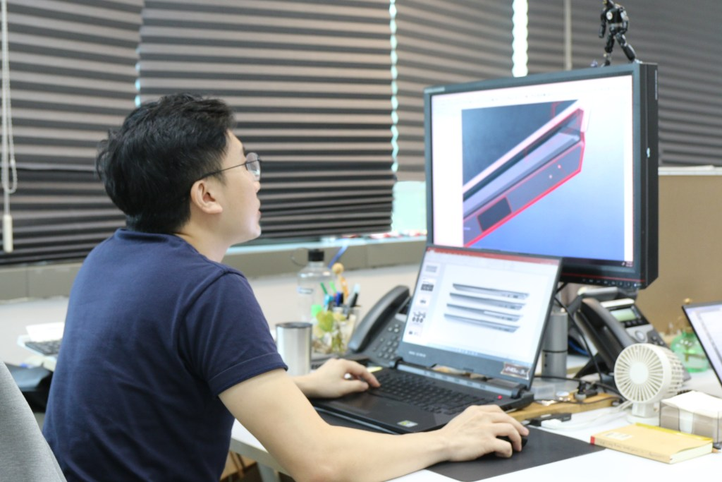 DC at laptop doing 3D renderings