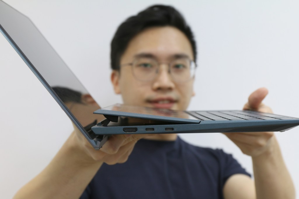 DC holding ZenBook Duo UX482 to show side view angle